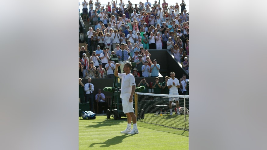 Lleyton Hewitt of Australia gestures to the crowd after being defeated by Jarkko Nieminen of Finland in the men's singles first round match at the All England Lawn Tennis Championships in Wimbledon, London, Monday June 29, 2015. (AP Photo/Tim Ireland)