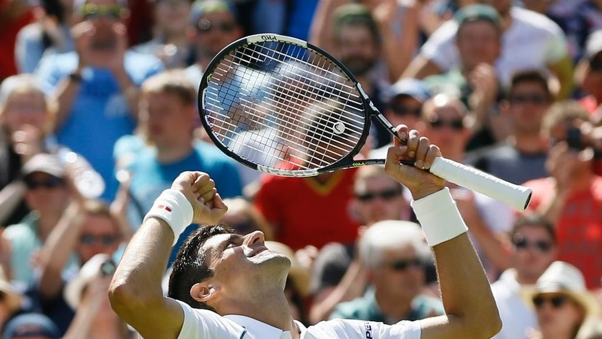 Novak Djokovic of Serbia celebrates defeating Philipp Kohlschreiber of Germany in their men's singles first round match at the All England Lawn Tennis Championships in Wimbledon, London, Monday June 29, 2015. Djokovic won the match 6-4, 6-4, 6-4. (AP Photo/Kirsty Wigglesworth)