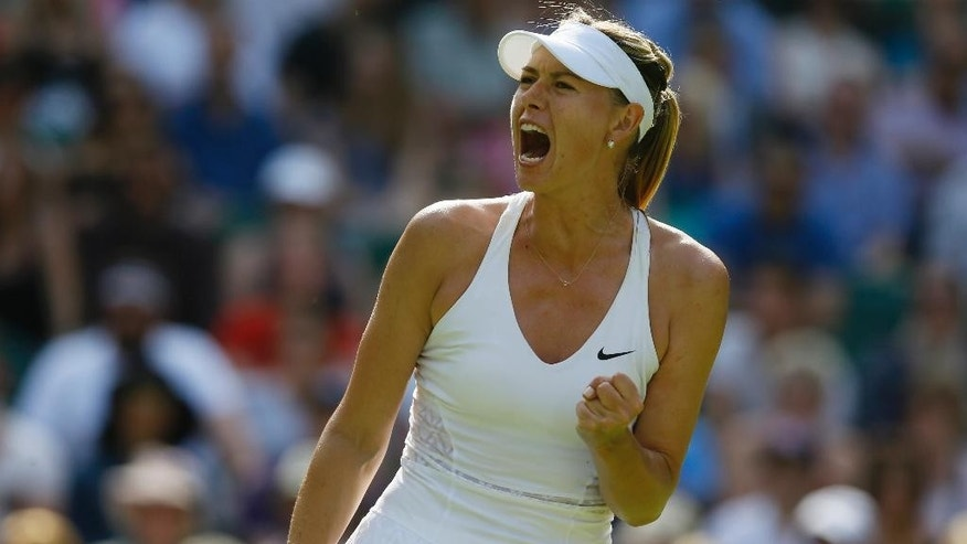 Maria Sharapova of Russia celebrates winning a point against Johanna Konta of Britain during the women's singles first round match at the All England Lawn Tennis Championships in Wimbledon, London, Monday June 29, 2015. (AP Photo/Kirsty Wigglesworth)