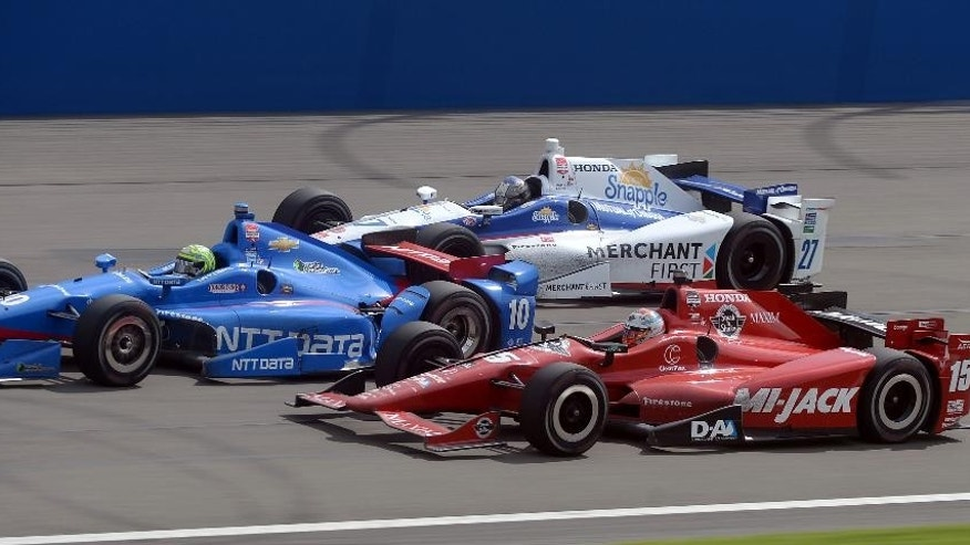 Tony Kanaan (10), Graham Rahal (15) and Marco Andretti (27) battle for the lead during the closing laps Saturday June 27, 2015 during the IndyCar auto race at Auto Club Speedway in Fontana, Calif. (AP Photo/Will Lester)