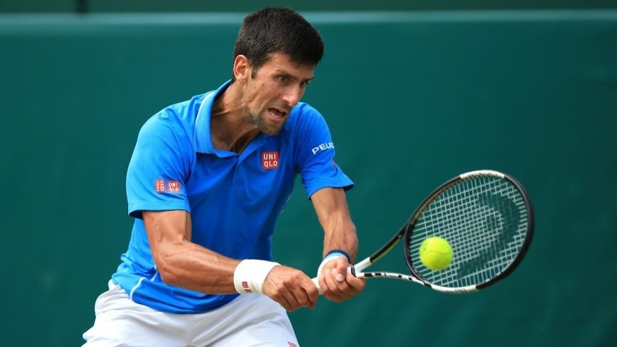 Novak Djokovic in action during his match with Alexander Zverev during day four of The Boodles at Stoke Park, near Stoke Poges, England, Friday June 26, 2015. (Mike Egerton/PA via AP)  UNITED KINGDOM OUT  NO SALES  NO ARCHIVE