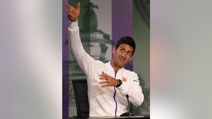 Current Wimbledon men's singles champion Serbia's Novak Djokovic gestures during  a press conference at the Wimbledon Championships at the All England Lawn Tennis and Croquet Club, in  Wimbledon London Sunday June 28, 2015.  The Wimbledon tennis championships begin on Monday. (Adam Davy/PA via AP) UNITED KINGDOM OUT