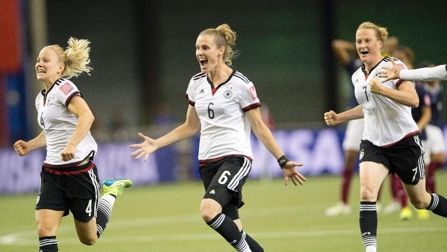 Germany's Leonie Maier (4), Simone Laudehr (6) and Melanie Behringer (7) react after defeating France on penalty kicks in a quarterfinal match in the FIFA Women's World Cup soccer tournament, Friday, June 26, 2015, in Montreal, Canada. (Ryan Remiorz/The Canadian Press via AP) MANDATORY CREDIT