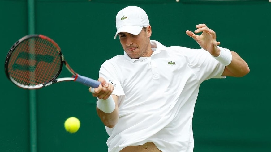 John Isner of the United States returns to Go Soeda of Japan during the men's singles first round match at the All England Lawn Tennis Championships in Wimbledon, London, Monday June 29, 2015. (AP Photo/Alastair Grant)