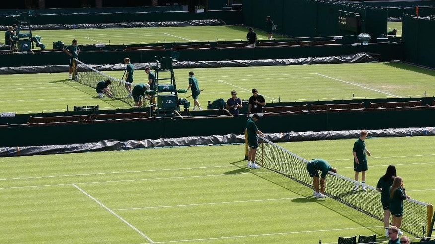 Courts are prepared ahead of the first day of play at the All England Lawn Tennis Championships in Wimbledon, London, Monday June 29, 2015. (AP Photo/Kirsty Wigglesworth)