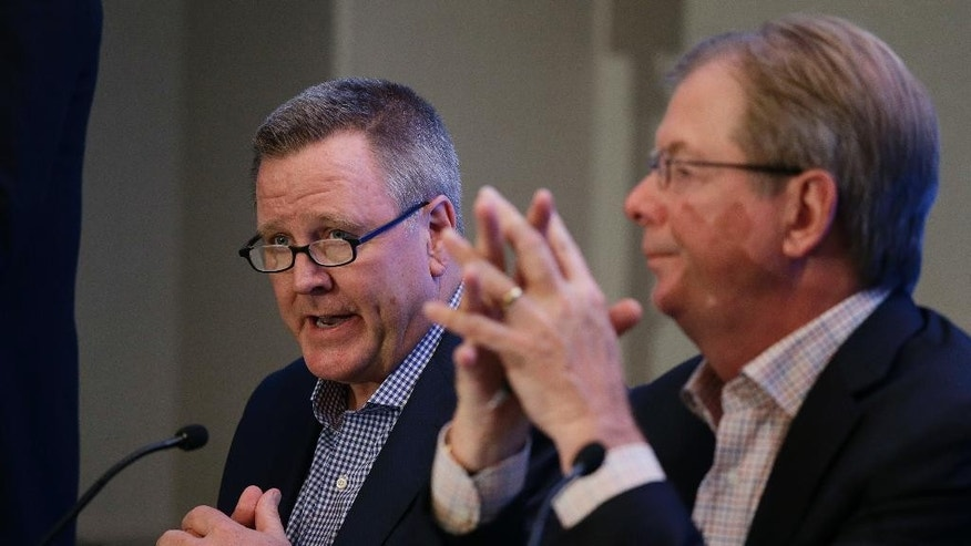 Scott Blackmun, left, U.S. Olympic Committee CEO, speaks as Larry Probst, right, USOC chairman, listens during a news conference Tuesday, June 30, 2015, in Redwood City, Calif. U.S. Olympic Committee leaders say they're sticking with Boston as their candidate for the 2024 Olympics. The USOC board met Tuesday to discuss the Boston bid, which has been troubled by tepid polling data and active opposition. (AP Photo/Eric Risberg)