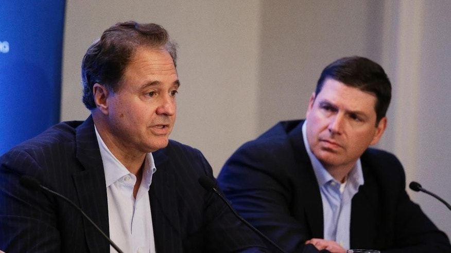 Steve Pagliuca, left, chairman of Boston 2024, speaks during a news conference as Roger Crandall, right, vice chair of Boston 2024, listens Tuesday, June 30, 2015, in Redwood City, Calif. U.S. Olympic Committee leaders say they're sticking with Boston as their candidate for the 2024 Olympics. The USOC board met Tuesday to discuss the Boston bid, which has been troubled by tepid polling data and active opposition. (AP Photo/Eric Risberg)