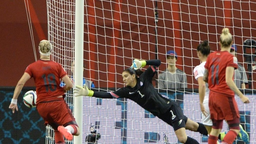 U.S. keeper Hope Solo watches as a Germany shot goes wide of the net during the second half of a semifinal in the Women's World Cup soccer tournament, Tuesday, June 30, 2015, in Montreal, Canada. (Ryan Remiorz/The Canadian Press via AP)