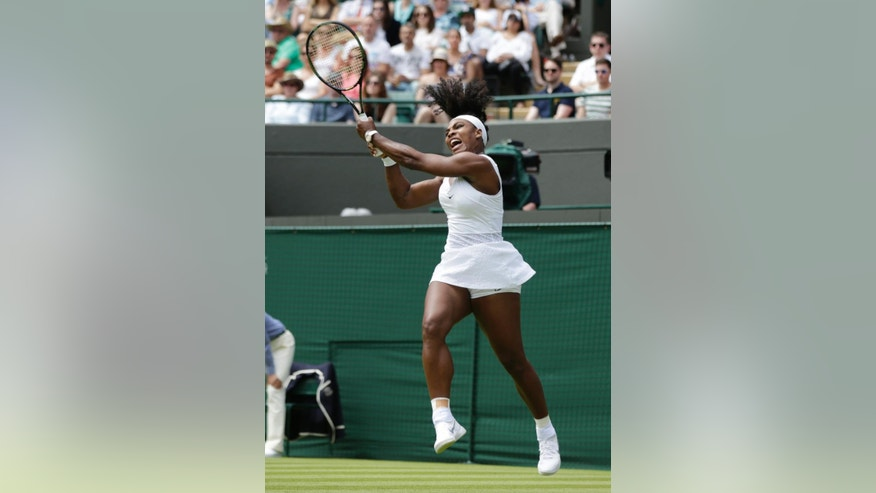 Serena Williams of the United States returns a ball to Margarita Gasparyan of Russia in a women's singles first round match at the All England Lawn Tennis Championships in Wimbledon, London, Monday June 29, 2015. (AP Photo/Pavel Golovkin)