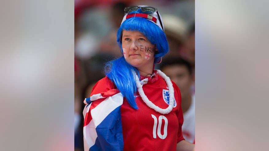 An England fan waits for Canada and England to play a quarterfinal of the Women's World Cup soccer tournament, Saturday, June 27, 2015, in Vancouver, British Columbia, Canada. (Darryl Dyck/The Canadian Press via AP)