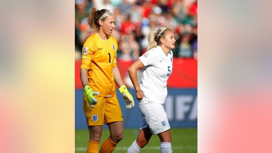 England goalkeeper Karen Bardsley and teammate Steph Houghton (5) react after giving up a goal in the last minutes against Japan during a semifinal in the FIFA Women's World Cup soccer tournament, Wednesday, July 1, 2015, in Edmonton, Alberta, Canada. Japan won 2-1. (Jeff McIntosh/The Canadian Press via AP)