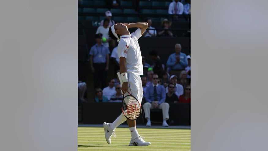 Kei Nishikori of Japan reacts after defeating Simone Bolelli of Italy in the men's singles first round match at the All England Lawn Tennis Championships in Wimbledon, London, Monday June 29, 2015. (AP Photo/Pavel Golovkin)