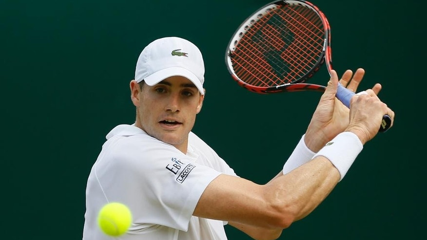 John Isner of the United States returns a shot to Matthew Ebden of Australia, during their singles match at the All England Lawn Tennis Championships in Wimbledon, London, Wednesday July 1, 2015. (AP Photo/Kirsty Wigglesworth)
