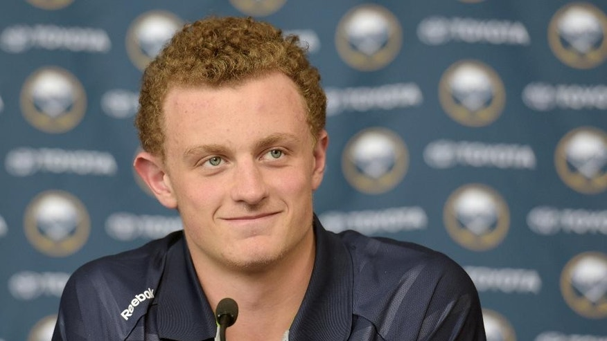 Jack Eichel pauses as he listens to a reporter during a press conference at the First Niagara Center Wednesday July 1, 2015, in Buffalo, N.Y. Eichel signed an NHL three-year, entry-level contract with the Buffalo Sabres.  (AP Photo/Gary Wiepert)