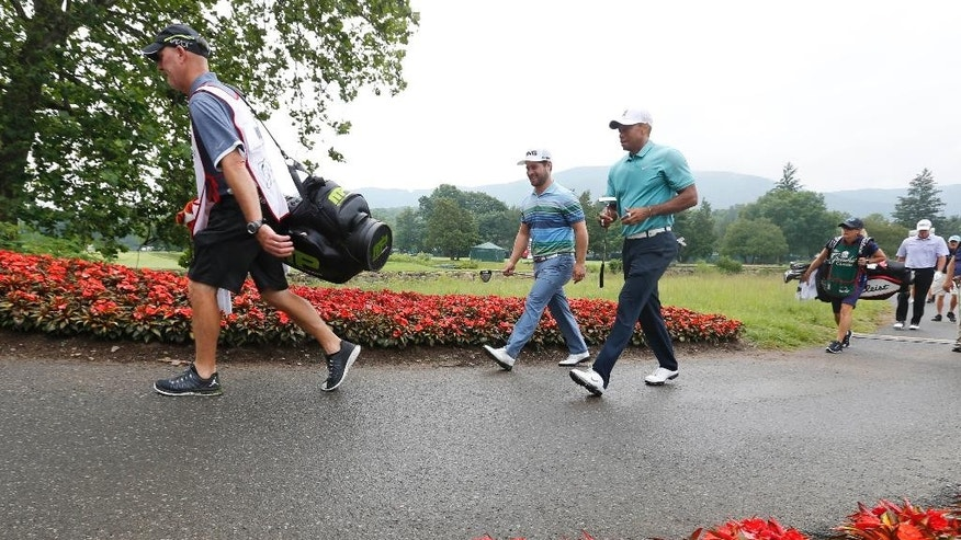 Tiger Woods, center right, walks with David Lingmerth, of Sweden, to the 16th green during the first round of the Greenbrier Classic golf tournament at the Greenbrier Resort  in White Sulphur Springs, W.Va., Thursday, July 2, 2015.  (AP Photo/Steve Helber)