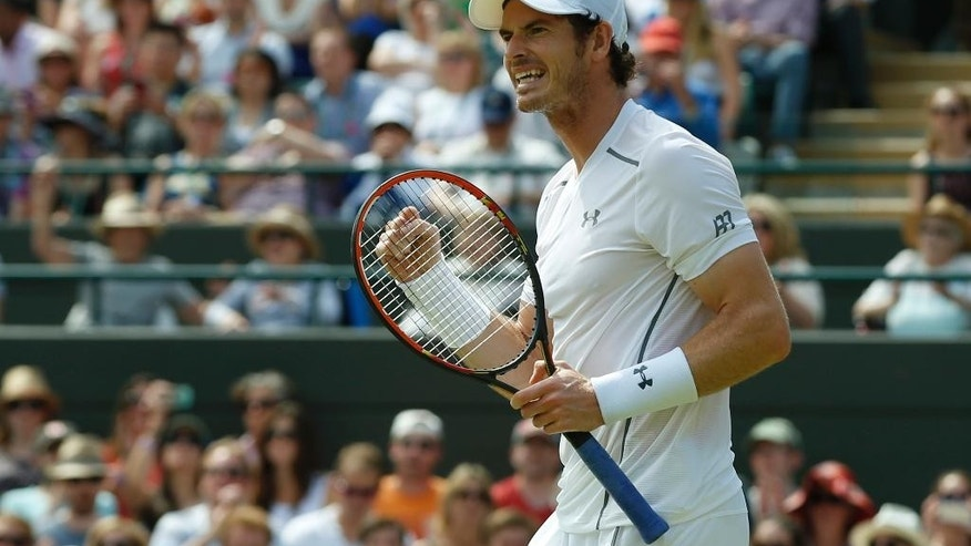 Andy Murray of Britain celebrates after winning the single match against Robin Haase of the Netherlands, at the All England Lawn Tennis Championships in Wimbledon, London, Thursday July 2, 2015. Murray won 6-1, 6-1, 6-4. (AP Photo/Alastair Grant)