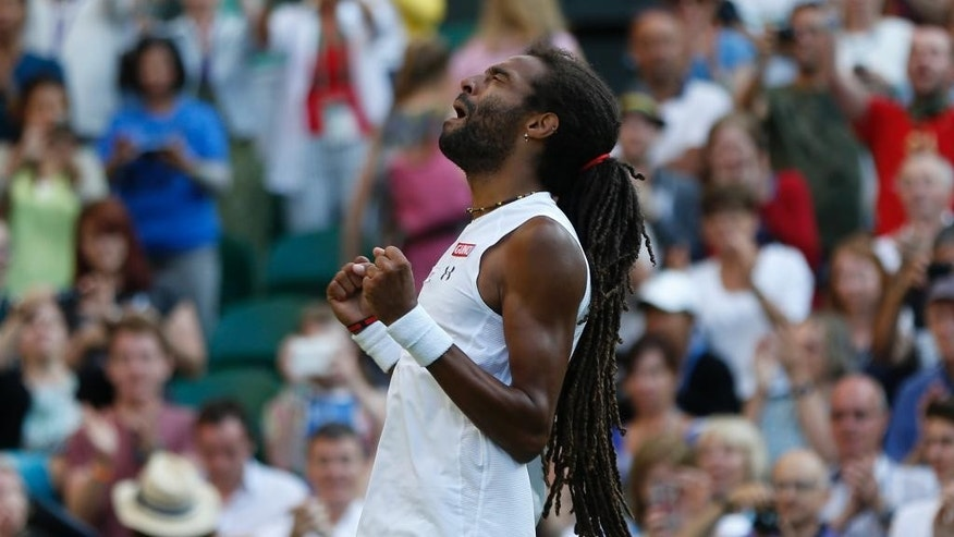 Dustin Brown of Germany, gestures after defeating Rafael Nadal of Spain, during their singles match, at the All England Lawn Tennis Championships in Wimbledon, London, Thursday July 2, 2015. (AP Photo/Pavel Golovkin)