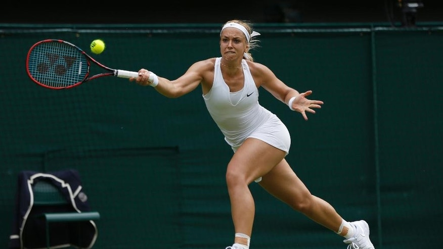 Sabine Lisicki of Germany returns a ball to Christina Mchale of the United States, during their singles match at the All England Lawn Tennis Championships in Wimbledon, London, Thursday July 2, 2015. (AP Photo/Pavel Golovkin)
