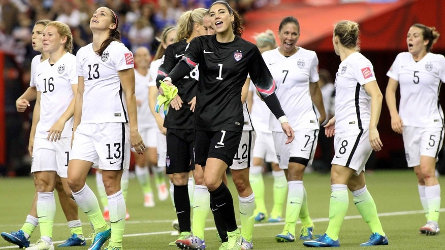 MONTREAL, QC - JUNE 30:  Alex Morgan #13 and Hope Solo #1 of the United States celebrate the 2-0 victory against Germany in the FIFA Women's World Cup 2015 Semi-Final Match at Olympic Stadium on June 30, 2015 in Montreal, Canada.  (Photo by Francois Laplante/FreestylePhoto/Getty Images)