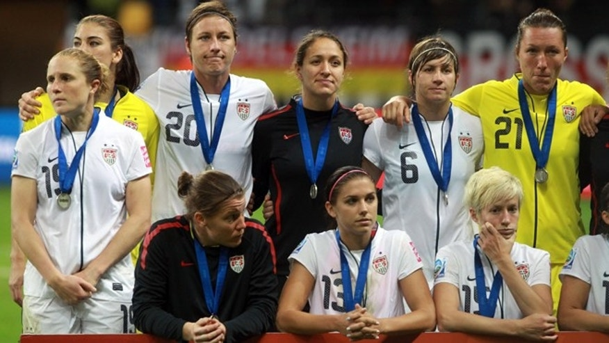The team of USA look dejected after World Cup Final match against Japan on July 17, 2011.