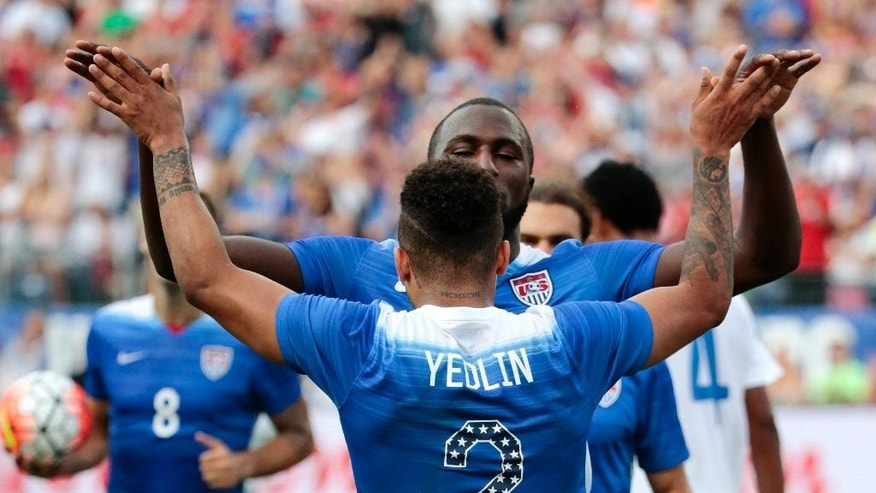 United States' DeAndre Yedlin (2) celebrates with Jozy Altidore after an own goal was scored by Guatemala's Carlos Castrillo during the first half of an international friendly soccer match Friday, July 3, 2015, in Nashville, Tenn. (AP Photo/Mark Humphrey)
