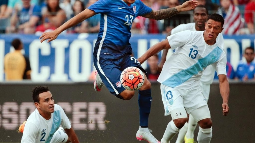 United States' Fabian Johnson midfielder (23) moves the ball between Guatemala defenders Carlos Castrillo (13) and Ruben Morales (2) during the first half of an international friendly soccer match Friday, July 3, 2015, in Nashville, Tenn. (AP Photo/Mark Humphrey)