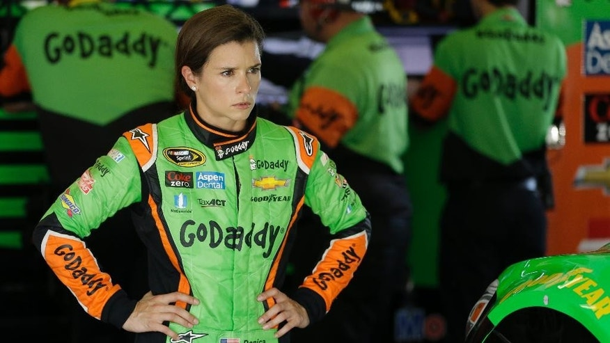 Danica Patrick walks through her garage after a NASCAR Sprint Cup practice session at Daytona International Speedway, Friday, July 3, 2015, in Daytona Beach, Fla. (AP Photo/John Raoux)
