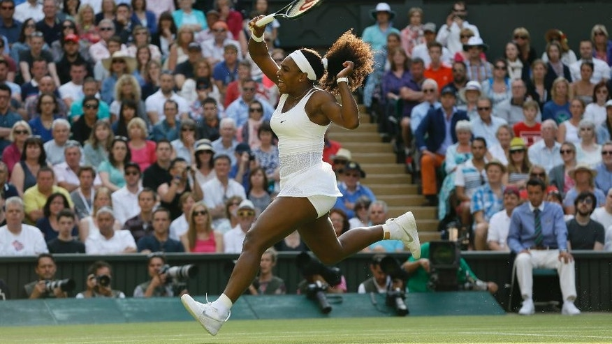 Serena Williams of the United States celebrates winning a point against Heather Watson of Britain, during their singles match, at the All England Lawn Tennis Championships in Wimbledon, London, Friday July 3, 2015. (AP Photo/Kirsty Wigglesworth)