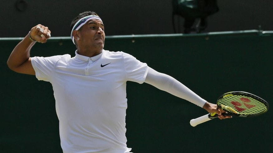 Nick Kyrgios of Australia celebrates winning a point against Milos Raonic of Canada, during their singles match at the All England Lawn Tennis Championships in Wimbledon, London, Friday July 3, 2015. (AP Photo/Tim Ireland)