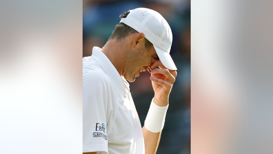 John Isner of the United States reacts as he plays Marin Cilic of Croatia during their singles match at the All England Lawn Tennis Championships in Wimbledon, London, Friday July 3, 2015. (AP Photo/Pavel Golovkin)