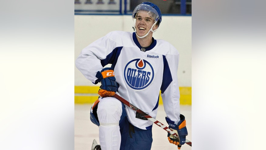 Edmonton Oilers first round pick Connor McDavid takes part in the Edmonton Oilers orientation camp in Edmonton, Alberta, Thursday, July 2, 2015. (Jason Franson/The Canadian Press via AP)