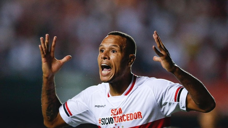 In this Thursday, March 19, 2015, file photo, Luis Fabiano of Brazil's Sao Paulo FC complains to an assistant referee after a goal scored by teammate Ricardo Centurion was disallowed, during a Copa Libertadores soccer match against Argentina's San Lorenzo, in Sao Paulo, Brazil. The Brazilian football confederation this year is giving referees permission to be ruthless with dissenting players, hoping to change a culture where complaints were widely accepted and often extreme. Brazilian referees are done with tolerating whining players. (AP Photo/Andre Penner, File)