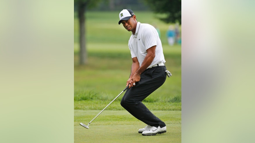 Tiger Woods reacts to a missed Birdie putt on the sixth hole during the second round of the Greenbrier Classic golf tournament at the Greenbrier Resort  in White Sulphur Springs, W.Va., Friday, July 3, 2015. Rain caused delays in play.  (AP Photo/Steve Helber)