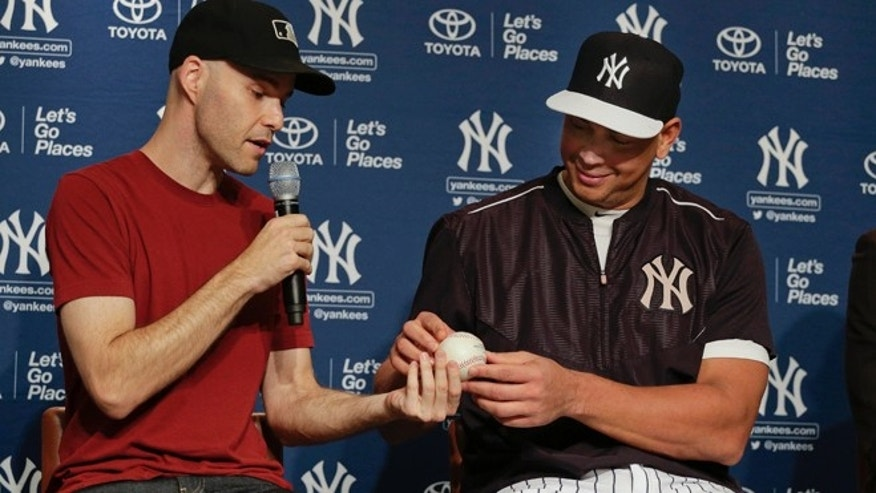 July 3, 2015: Zack Hample, left, presents New York Yankees Alex Rodriguez with the baseball on which Rodriguez got his 3,000th career hit during a news conference.