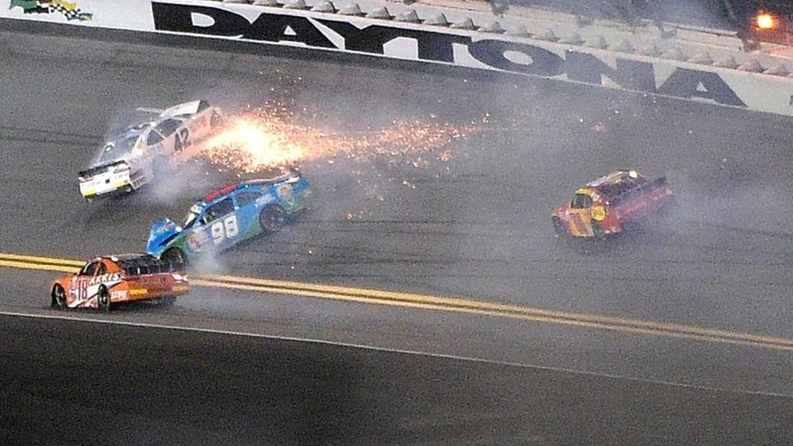 Brennan Poole (42) collides with Aric Almirola (98) in Turn 1 as Daniel Suarez (18) and Kasey Kahne, right, avoid them during the NASCAR Xfinity series auto race at Daytona International Speedway in Daytona Beach, Fla., Saturday, July 4, 2015. (AP Photo/Phelan M. Ebenhack)