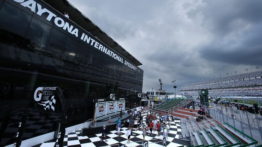 Storm clouds roll in over the Daytona International Speedway during a weather delay for the NASCAR Sprint Cup auto racing series qualifying, Saturday, July 4, 2015, in Daytona Beach, Fla. (AP Photo/John Raoux)