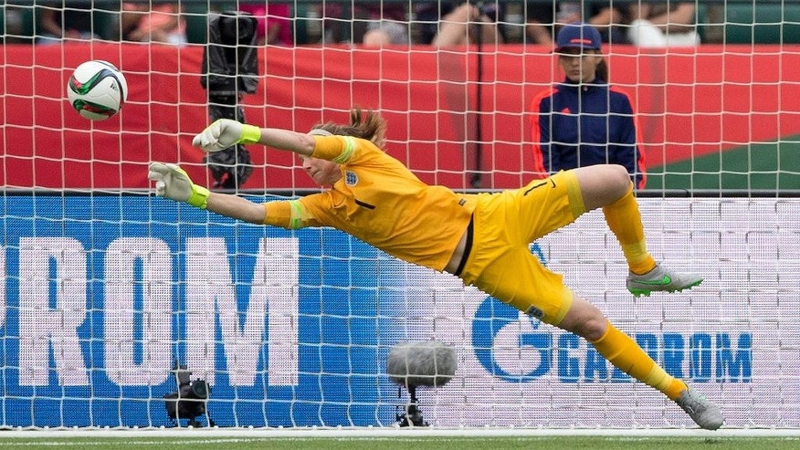 England's goalkeeper Karen Bardsley (1) makes a save against Germany during second-half action of the FIFA Women's World Cup soccer third-place match in Edmonton, Alberta, Canada, on Saturday, July 4, 2015. (Jason Franson/The Canadian Press via AP) MANDATORY CREDIT