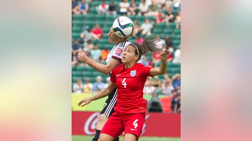 England's Fara Williams (4) and Germany's Melanie Behringer (7) vie for the ball during first-half action of a FIFA Women's World Cup soccer game in Edmonton, Alberta, Canada, on Saturday, July 4, 2015. (Jason Franson/The Canadian Press via AP) MANDATORY CREDIT