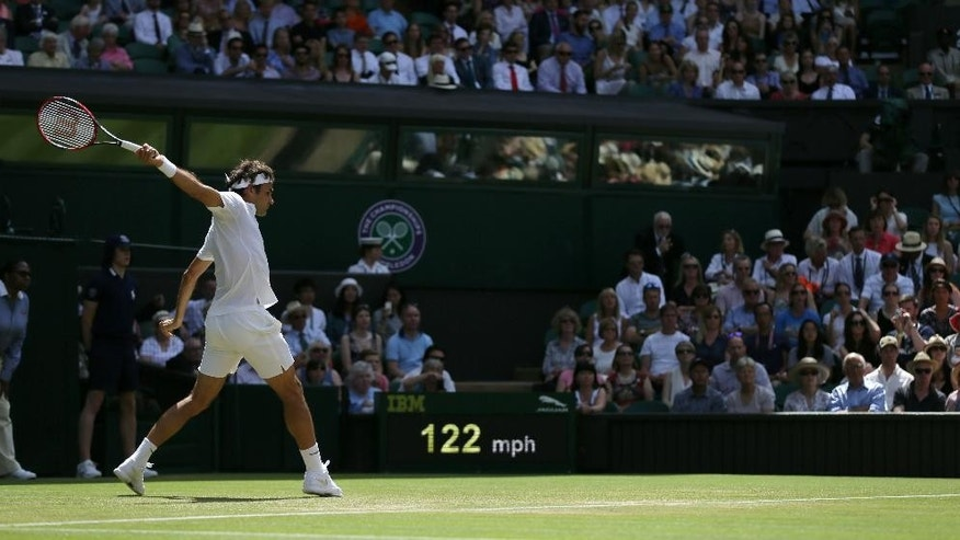 Roger Federer of Switzerland returns a shot to Sam Groth of Australia during their singles match at the All England Lawn Tennis Championships in Wimbledon, London, Saturday July 4, 2015. (AP Photo/Tim Ireland)