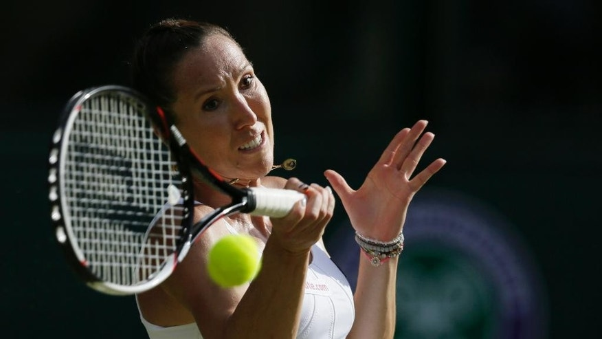 Jelena Jankovic of Serbia returns a ball to Petra Kvitova of the Czech Republic during their singles match at the All England Lawn Tennis Championships in Wimbledon, London, Saturday July 4, 2015. (AP Photo/Tim Ireland)