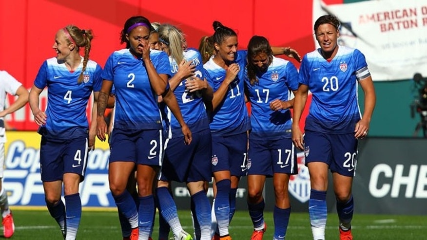 ST. LOUIS, MO - APRIL 4: Members of the US Women's National team celebrate after scoring a goal against New Zealand at Busch Stadium on April 4, 2015 in St. Louis, Missouri.  (Photo by Dilip Vishwanat/Getty Images)