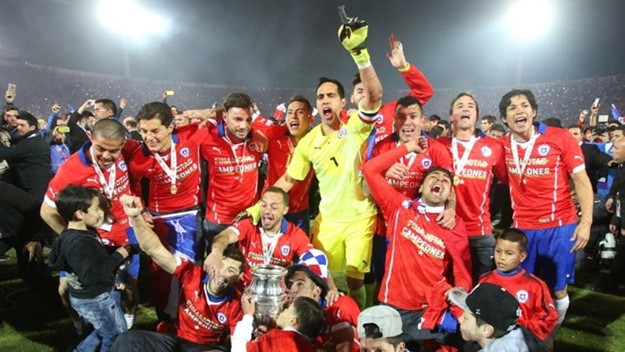 July 4, 2015: Chile's players celebrate with the Copa America trophy after defeating Argentina in the final soccer match at the National Stadium in Santiago, Chile.