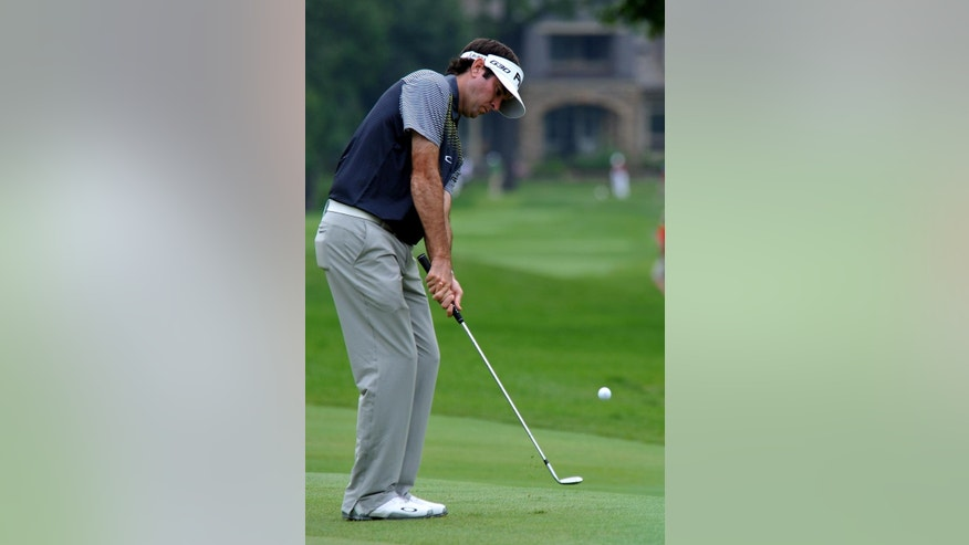 Bubba Watson chips onto the fourth green during the final round of the Greenbrier Classic golf tournament at Greenbrier Resort in White Sulphur Springs, W.Va., Sunday, July 5, 2015. (AP Photo/Chris Tilley)