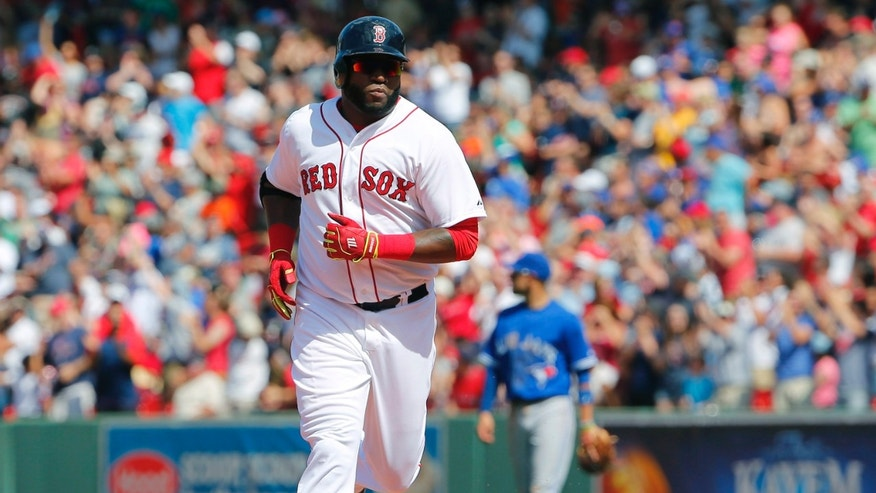 Boston Red Sox designated hitter David Ortiz rounds the bases after hitting a solo home run against the Toronto Blue Jays during the sixth inning of a baseball game at Fenway Park in Boston Saturday, June 13, 2015. (AP Photo/Winslow Townson)