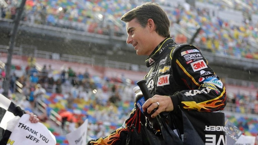 Jeff Gordon greets fans during driver introductions before the NASCAR Sprint Cup series auto race at Daytona International Speedway, Sunday, July 5, 2015, in Daytona Beach, Fla. Gordon is retiring at the end of the season and this will be his last race at Daytona. (AP Photo/Terry Renna)