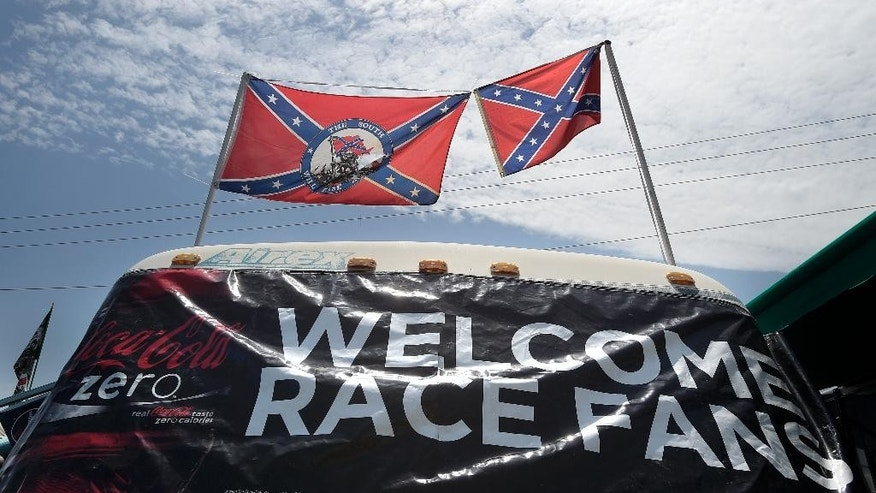 Confederate flags fly on top of a motor home at Daytona International Speedway, Saturday, July 4, 2015, in Daytona Beach, Fla. NASCAR and the speedway offered to replace any flag a race brings to the track with an American flag. (AP Photo/Phelan M. Ebenhack)