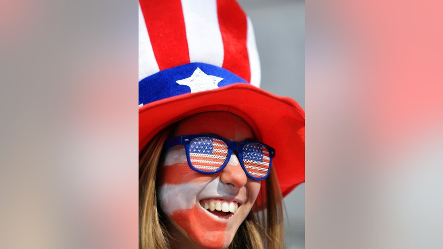 Camila Turati, of Orange County, Calif., stands outside BC Place stadium before the FIFA Women's World Cup soccer championship between the United States and Japan later in the day, in Vancouver, British Columbia, Canada, Sunday, July 5, 2015. (AP Photo/Elaine Thompson)