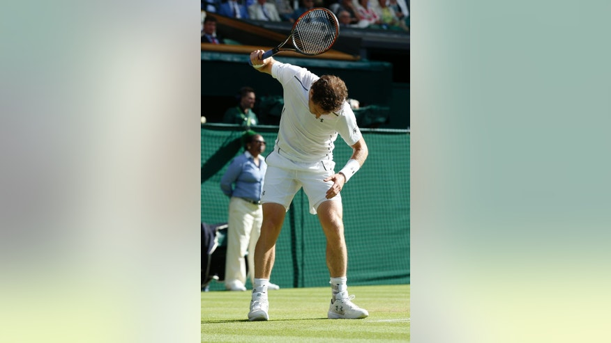 Andy Murray of Britain reacts in frustration after losing a point to Ivo Karlovic of Croatia during their singles match at the All England Lawn Tennis Championships in Wimbledon, London, Monday July 6, 2015. (AP Photo/Alastair Grant)