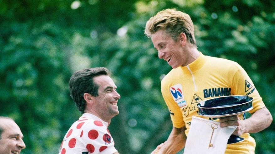 FILE - In this Sunday, July 27, 1986 file photo, five-time winner Bernard Hinault of France, left, congratulates Tour de France winner Greg Lemond of the United States in Paris. LeMond was at the peak of cycling in 1987 after becoming the first American to win the Tour de France the previous year. LeMond didn't get to get defend his title in 1987 after being shot accidentally by his brother-in-law while they were turkey hunting. (AP Photo/Pierre Gleizes, File)