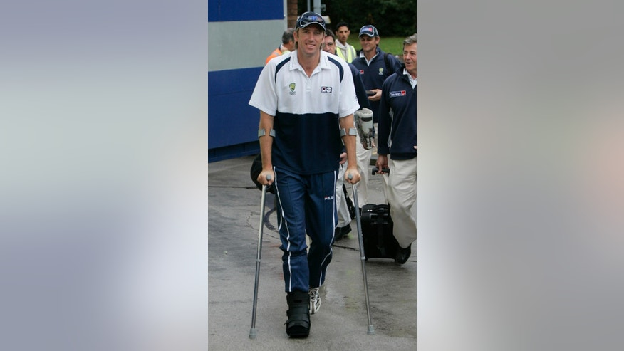 FILE - In this Friday, Aug. 5, 2005 file photo, Australia bowler Glenn McGrath walks with the aid of crutches as he arrives at Edgbaston cricket ground in Birmingham, England, before the second day of the second Ashes Test match against England. McGrath had to miss one of the five test matches in the 2005 series in England after sustaining an injury while messing around with a teammate with a soccer ball. McGrath was running to catch the ball, NFL/rugby-style when he stood on a cricket ball and damaged a ligament. (AP Photo/Matt Dunham)